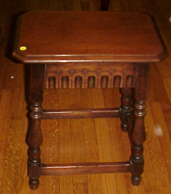 31  KITTINGER  WORTH WHILE FURNITURE  SIDE TABLE  Solid walnut  incised  carving to the apron  stretchers between each of the 4 legs  metal label. auction Results