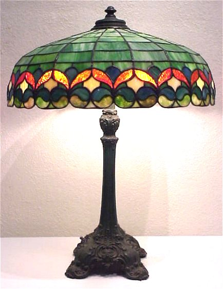 53A WILKINSON LEADED GLASS TABLE LAMP Primarily Green Slag Colorization With Red Blue Carmel And Rose Colored Cut To Form Ornate Floral Bordered