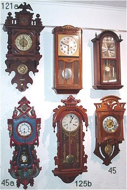 121a german wall clock carved eagle finial over lion masqueron mahogany case 3u0027h with pendulum and key est